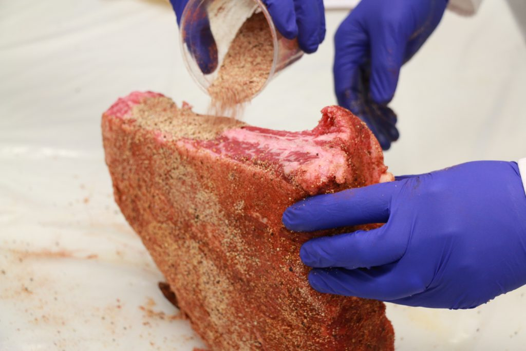 Applying seasonings to beef ribs