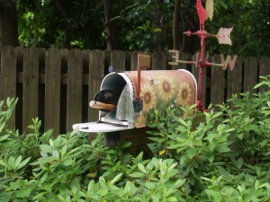 Attractive and functional, a decorated mailbox keeps essential, frequently used tools handy where they are needed.