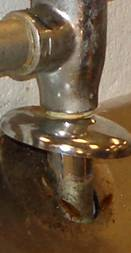 Image of plumbing pipe at floor; Small places that can lead to pest problems