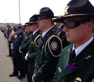 Honor Guard members stand at attention